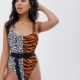 belted swimsuit in animal clash - Multi
